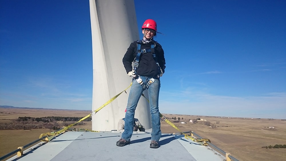 Student from Laramie Community College's Wind Energy program in the field