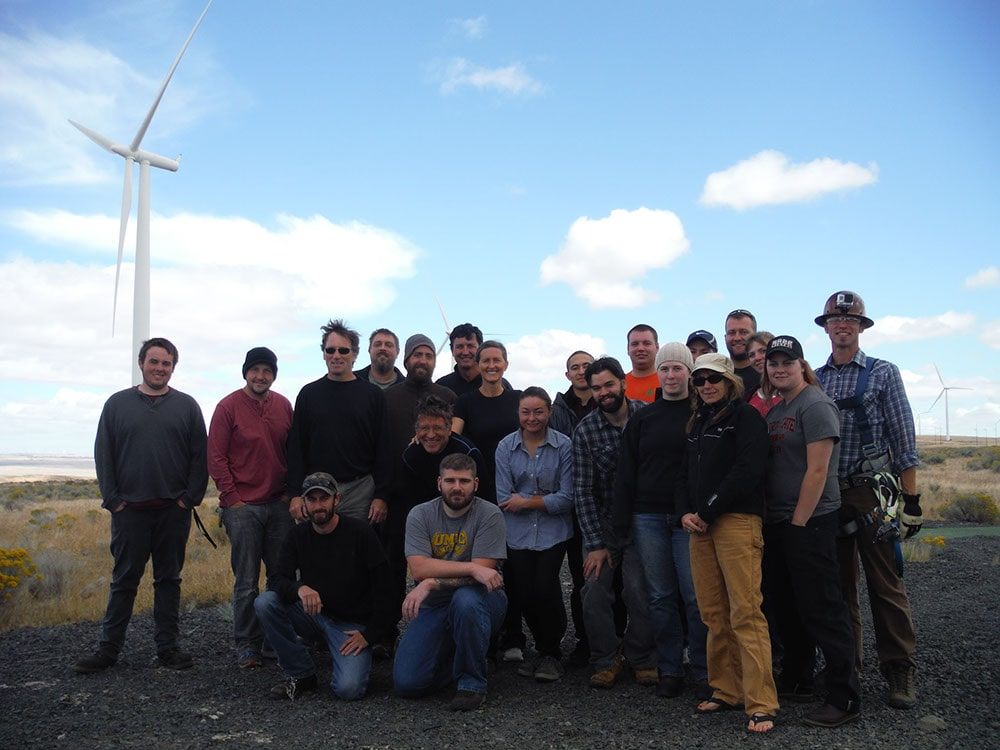 Students from the Columbia Gorge Wind Energy program in front of a wind turbine
