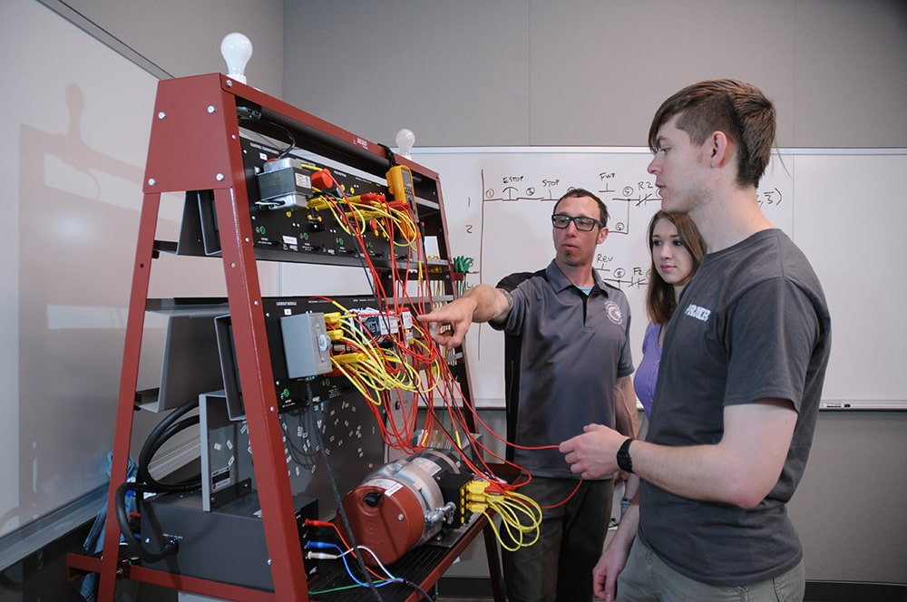 Students in the Wind Energy program at Columbia Gorge examining circuits