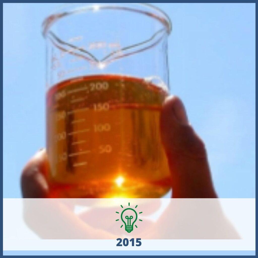 Glass beaker with orange liquid - 2015