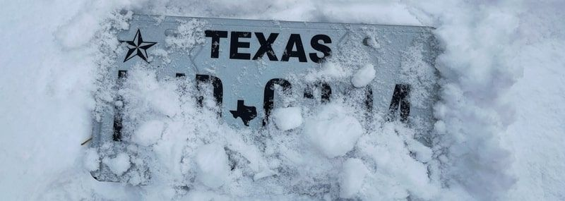 Texas license plate in the snow