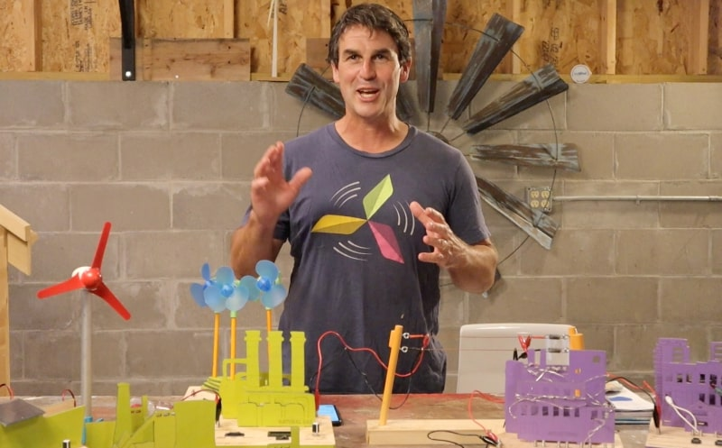 Man doing wind energy experiments with colorful equipment
