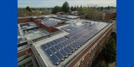 Solar panels on rooftop at school in Oregon.