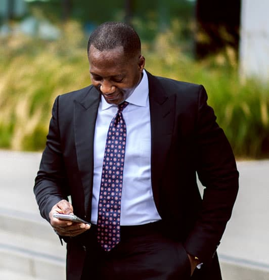 attorney anthony ifediba looking at phone