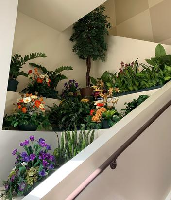 Indoor artificial plantscaping with CA silk flowers