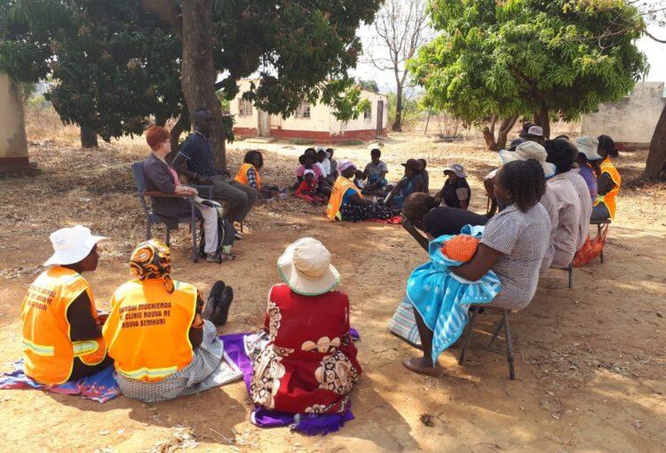 women sitting under tree