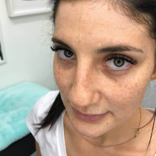 Eyewonderlust Cleaning Your Eyelash Extensions Blog - Woman with Long Dark Wavy Lashes Closeup