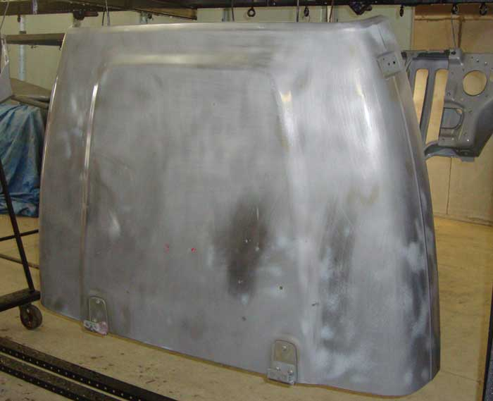 Jeep hood staged on rack to be powder coated. Powder coating Indianapolis, Moorseville, Brownsburg, Greenwood, Smith Valley, Franklin, Bargersville, Bloomington, Martinsville, Shelbyville, Lafayette, Lebanon, Plainfield, Avon, Clayton, Greenfield, Anderson, Pendleton, Fortville, McCordsville, Lawrence, Beech Grove, Noblesville, Carmel, Fishers and Whiteland Indiana.