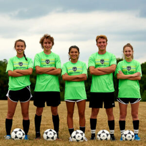 high school soccer players posing for camera