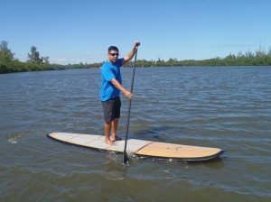 Riding a basilisk stand up paddle board