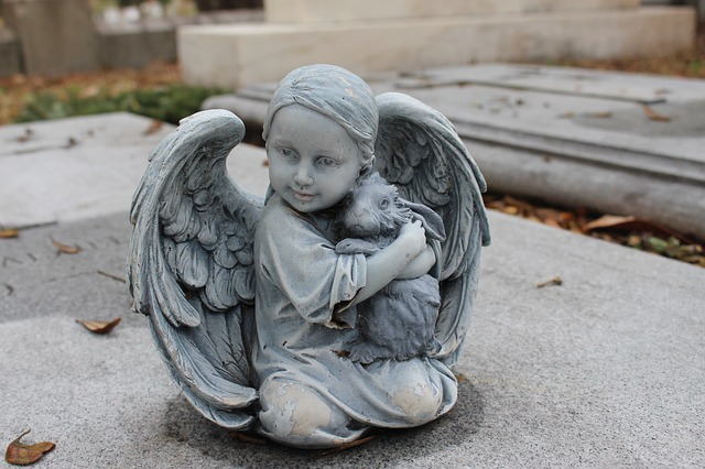 Mortuary Statue of angel and rabbit hugging