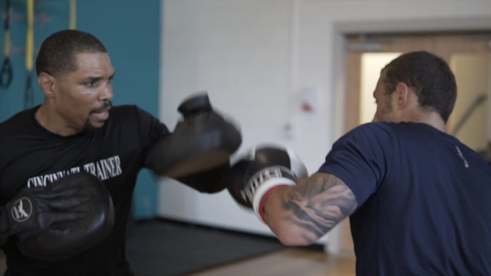 Zachary Thomas Boxing Trainer working with client