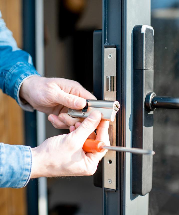 closeup of man holding a door hinge