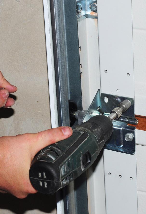 closeup of drill in fixing garage door