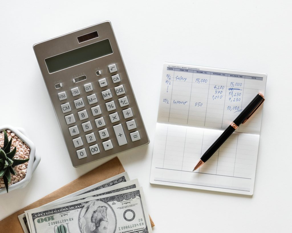 Accountant are using a calculator to Calculate Taxes