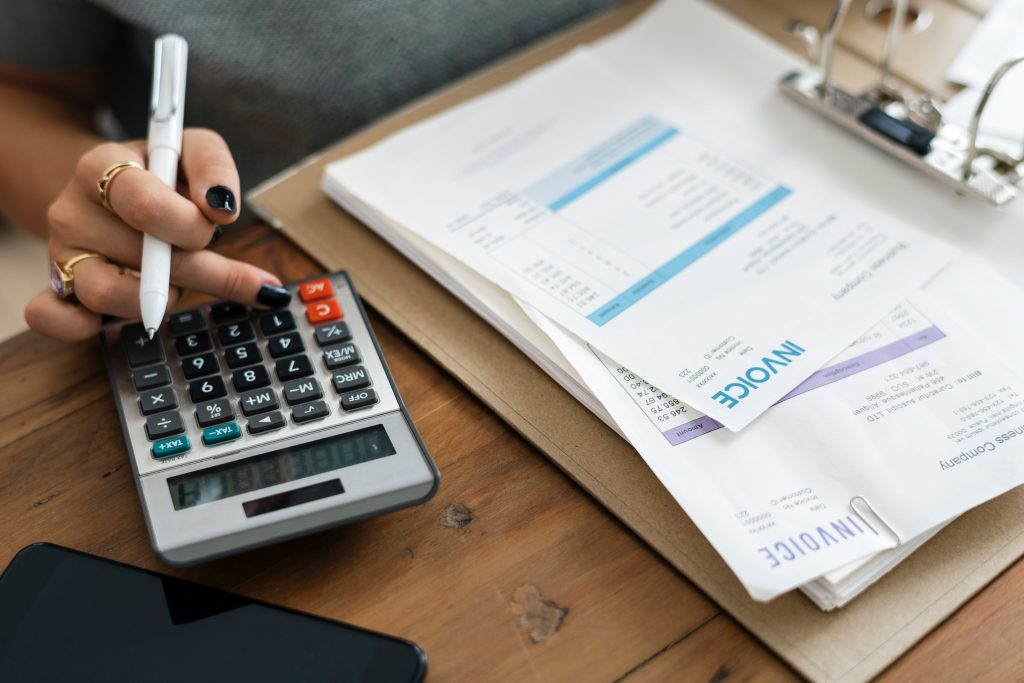Accountant hands with calculator