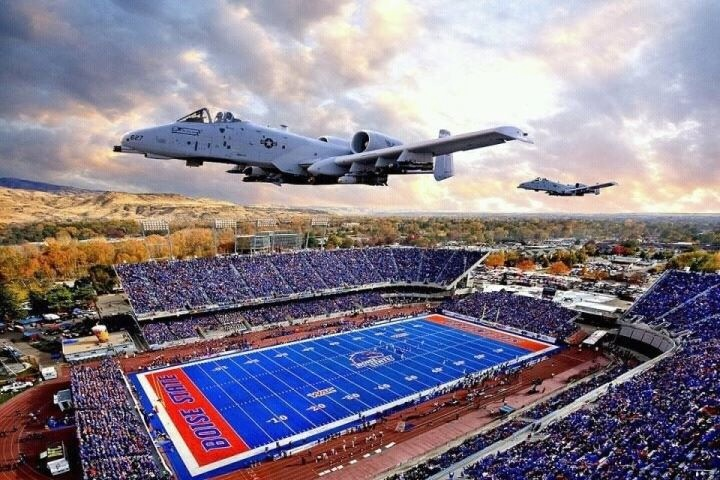 A jet taking off above a football stadium