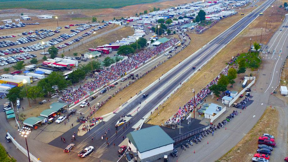 A racetrack with hundreds of people in the audience