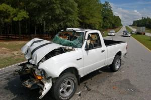 Pickup truck versus log truck