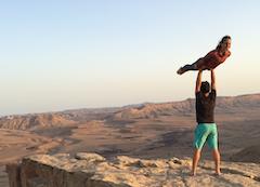 Rob Matzkin doing acro yoga in a canyon
