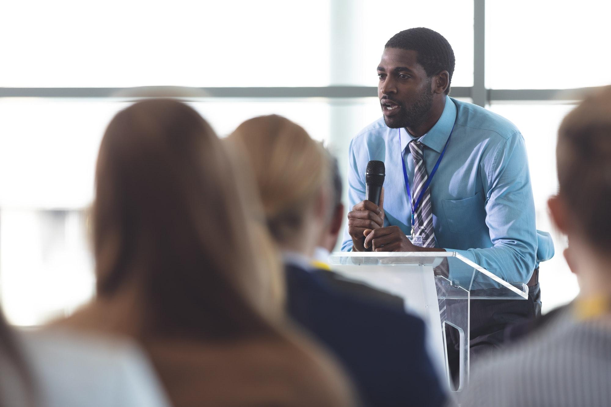 African-American businessman speaker speaking in a business seminar