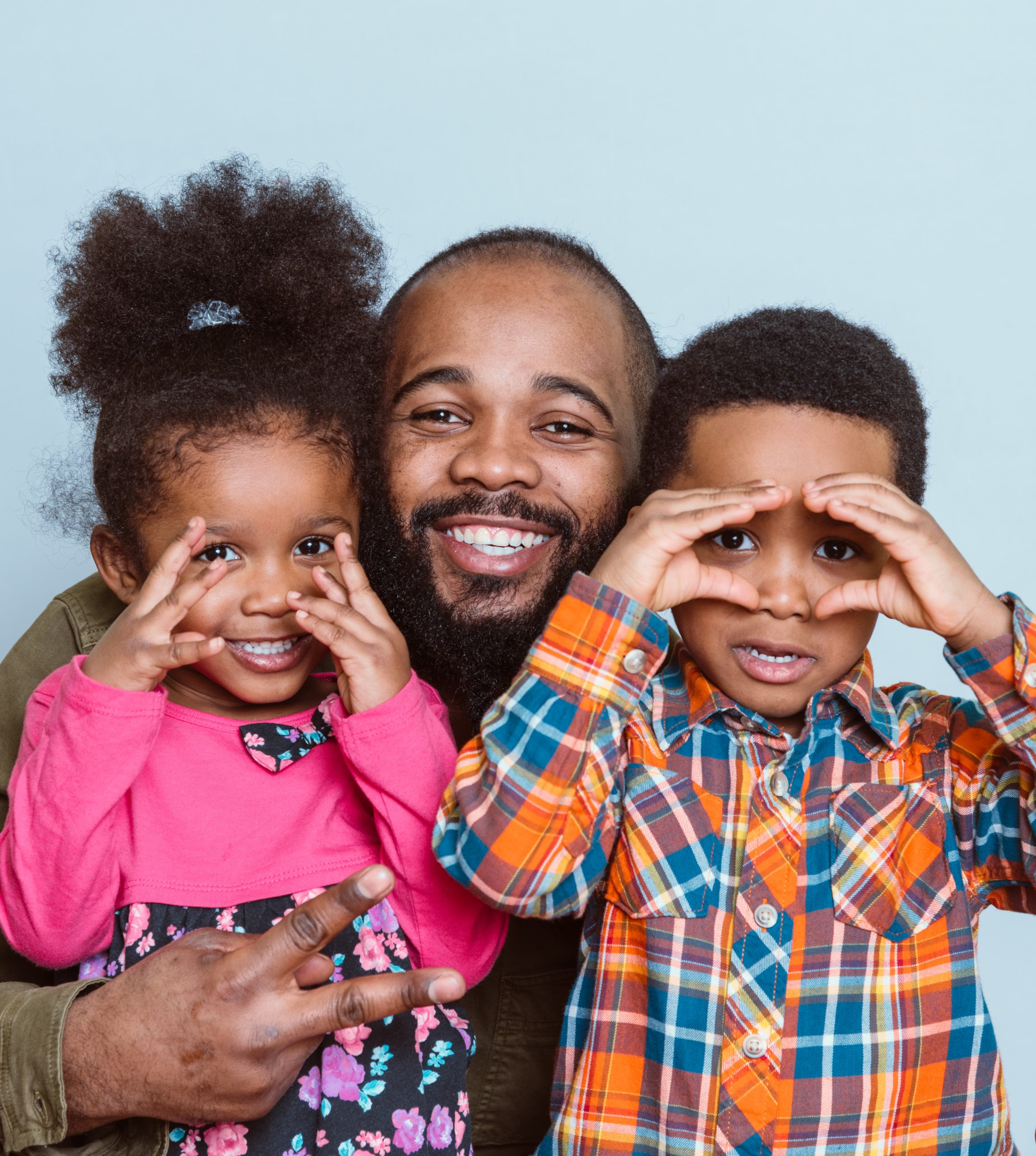 black-father-and-two-diverse-kids-looking-happy-an-B9S8THV