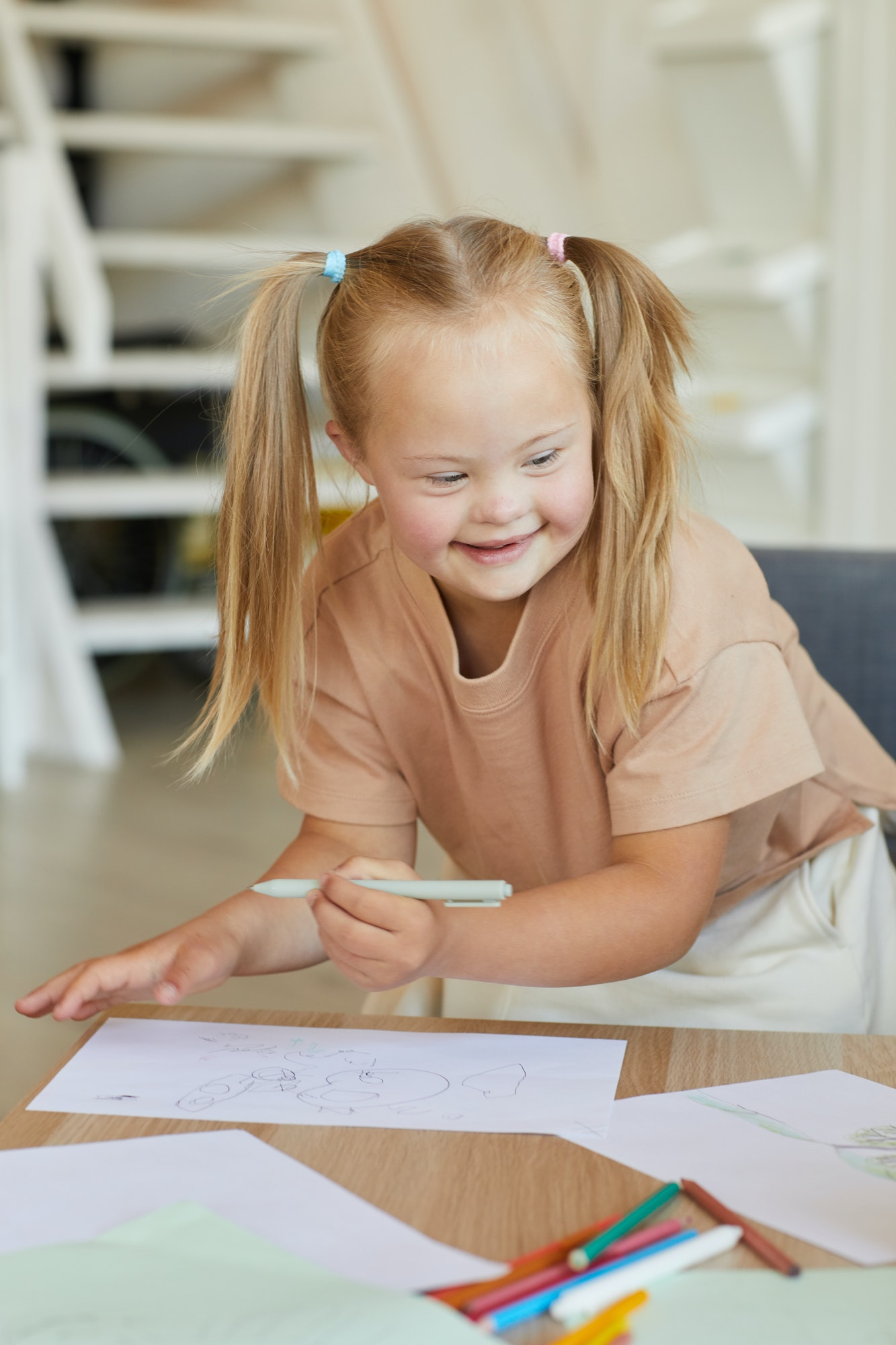 Cheerful Girl with Down Syndrome Enjoying Drawing