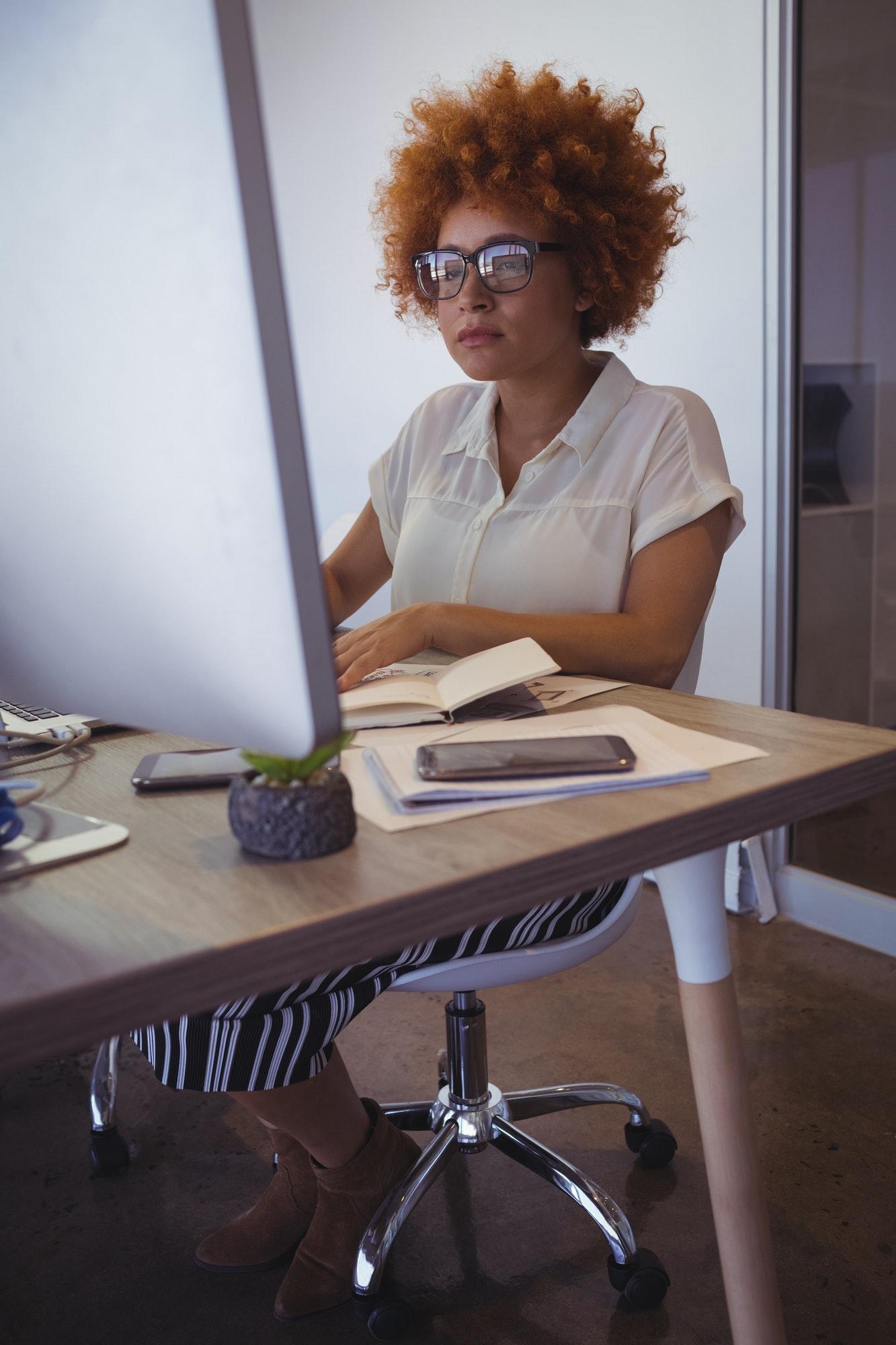 Focused entrepreneur working in office