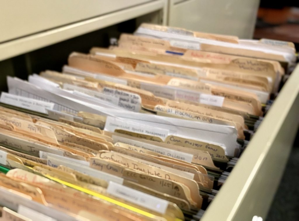 Paper files in a filing cabinet, files, office, filing system, documents, documentation, work