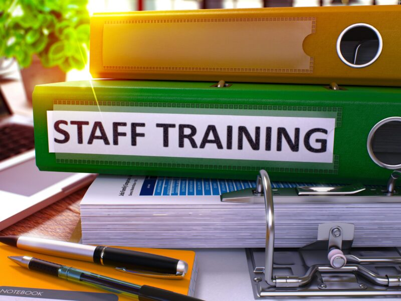 Staff,Training,-,Green,Office,Folder,On,Background,Of,Working