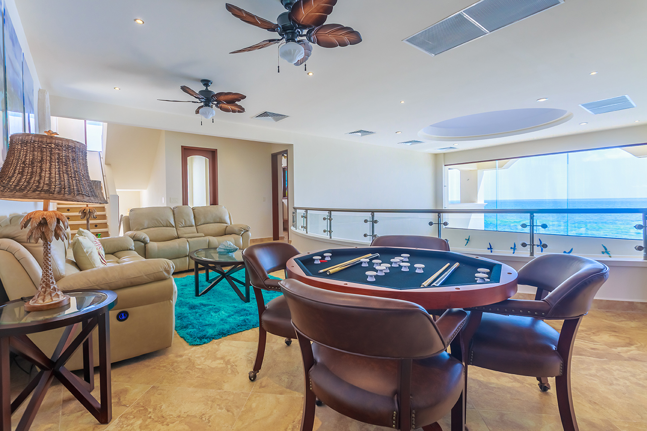 Upstairs living area with game table