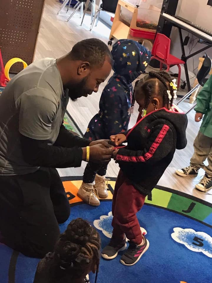 teacher working with pre-k student