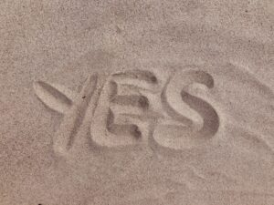 qualify for factoring blog feature image - word yes written in sand