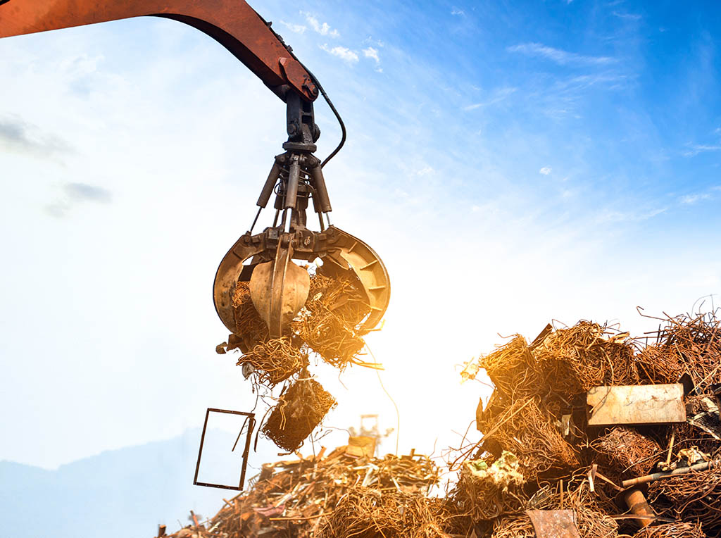Claw grabbing scrap with sunlight behind