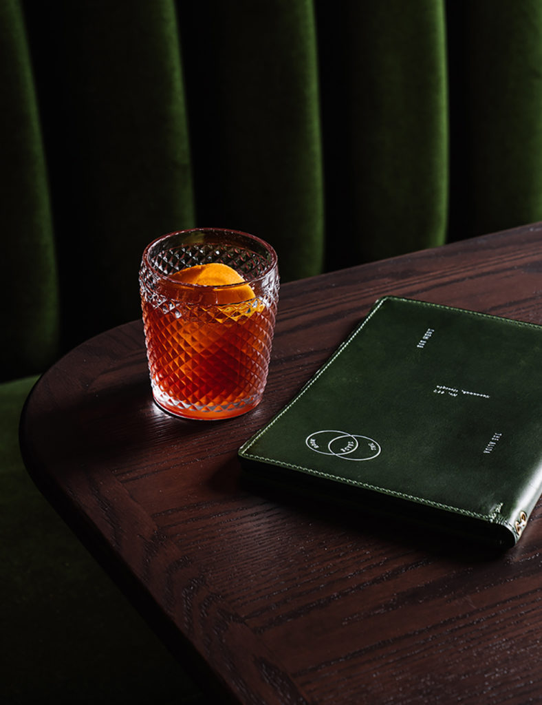 Table with menu and cocktail