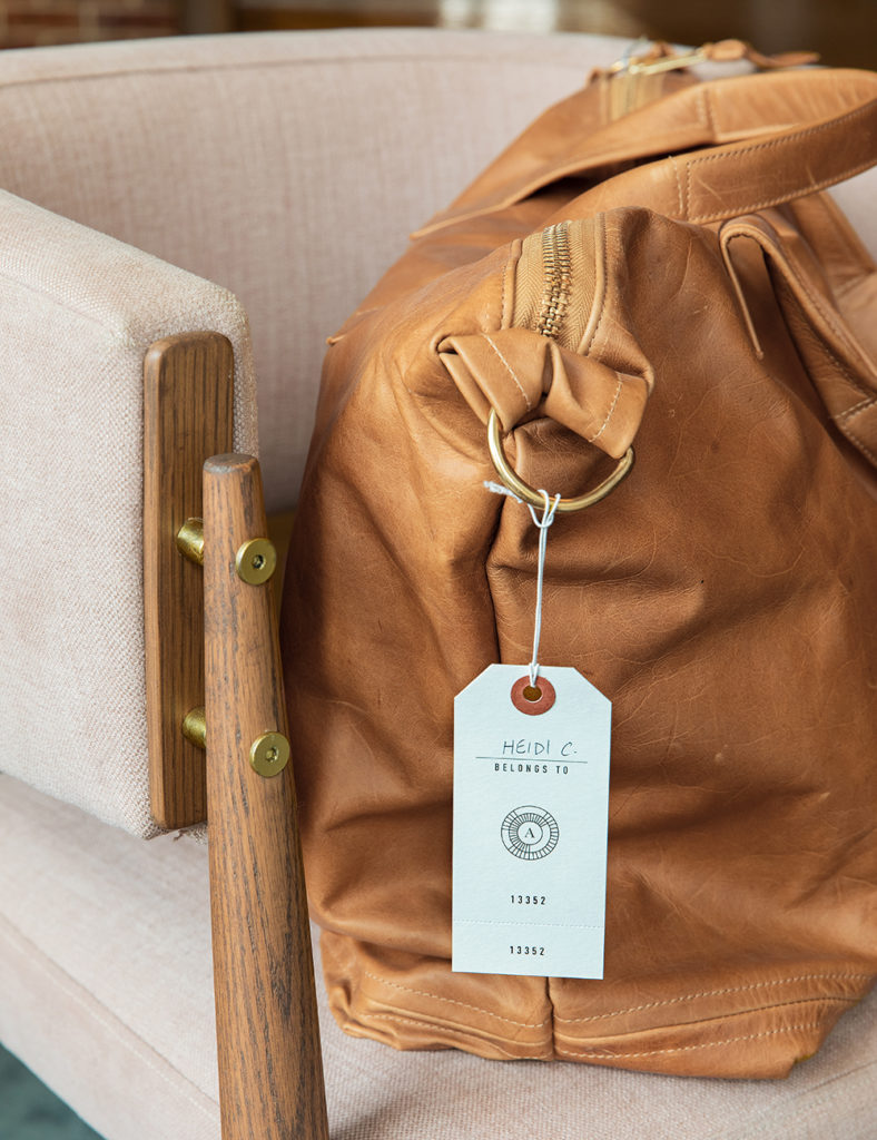 Luggage with branded tag at The Alida