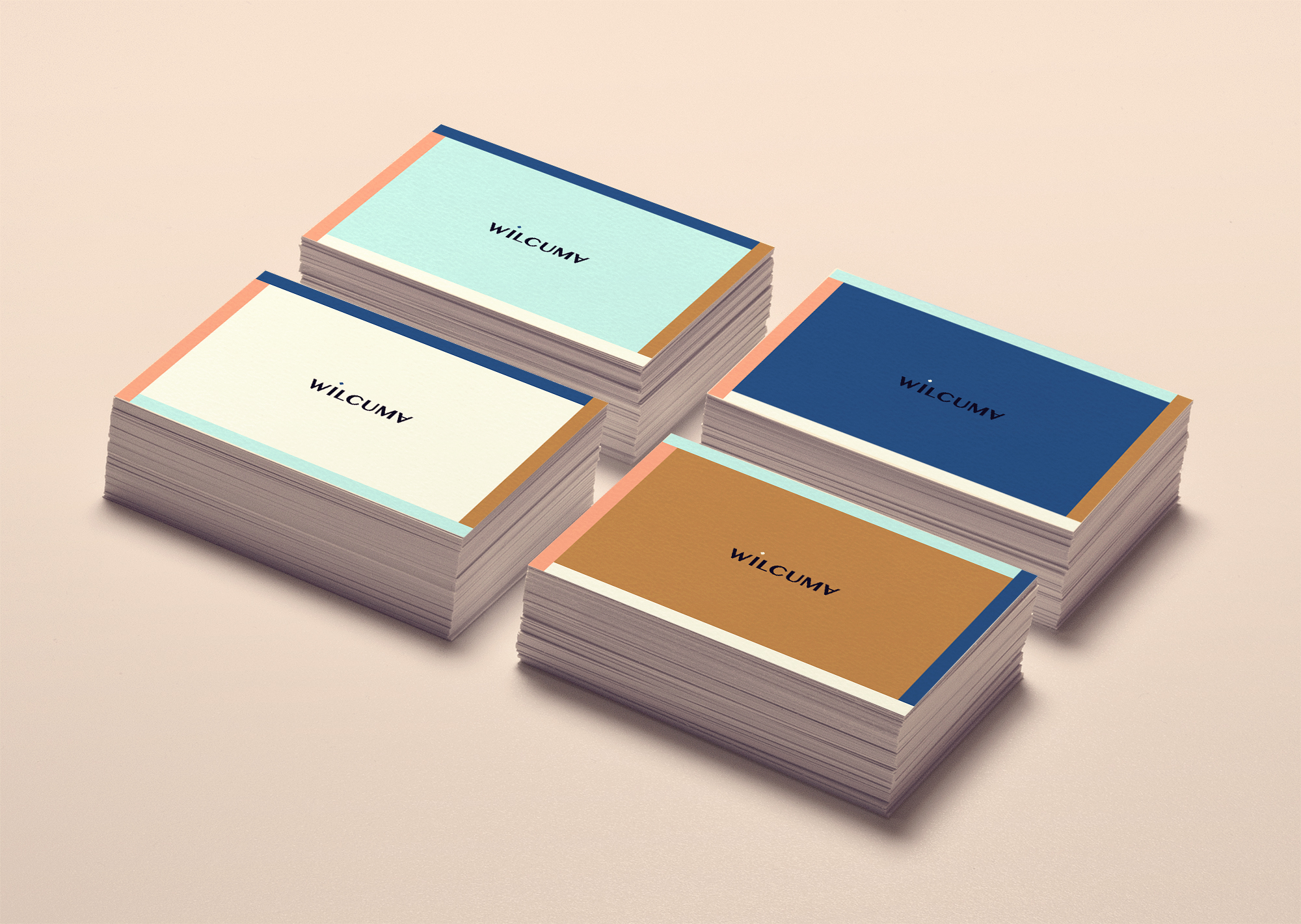 stacks of Wilcuma business cards
