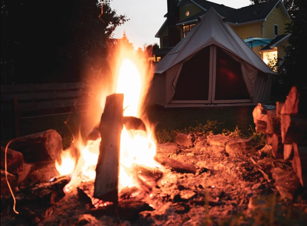 campfire near glamping tent