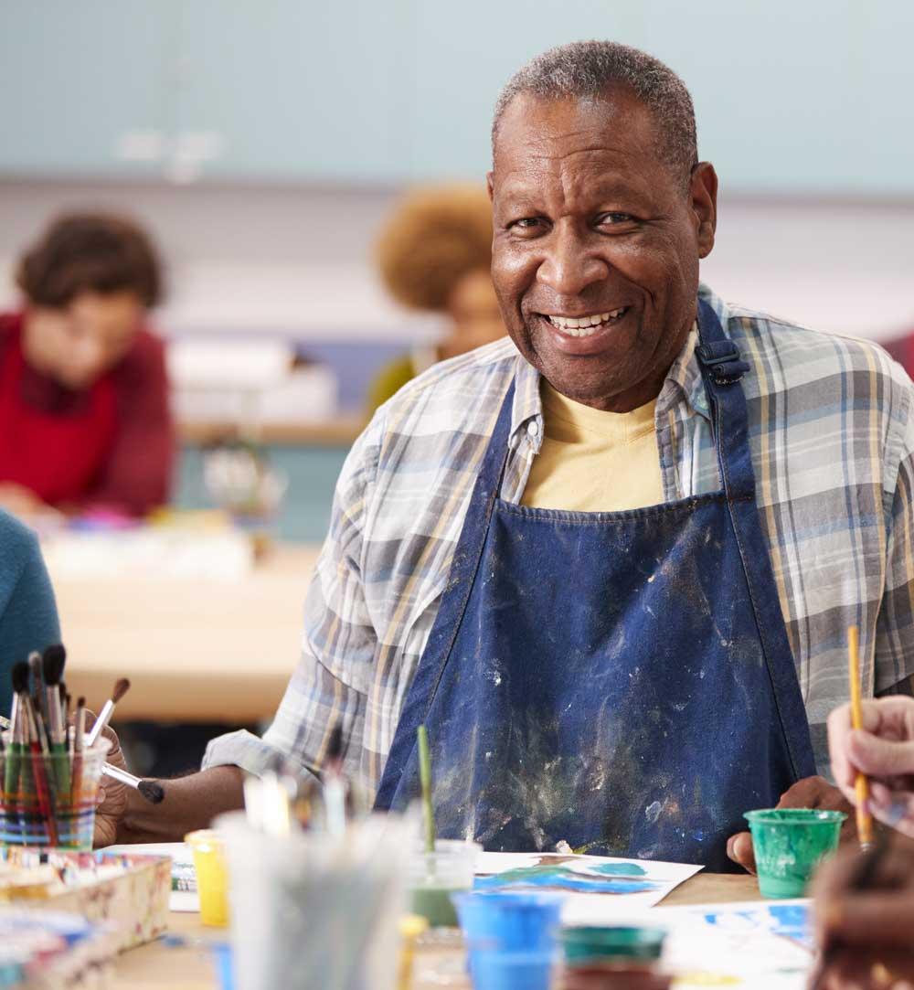 Smiling man painting