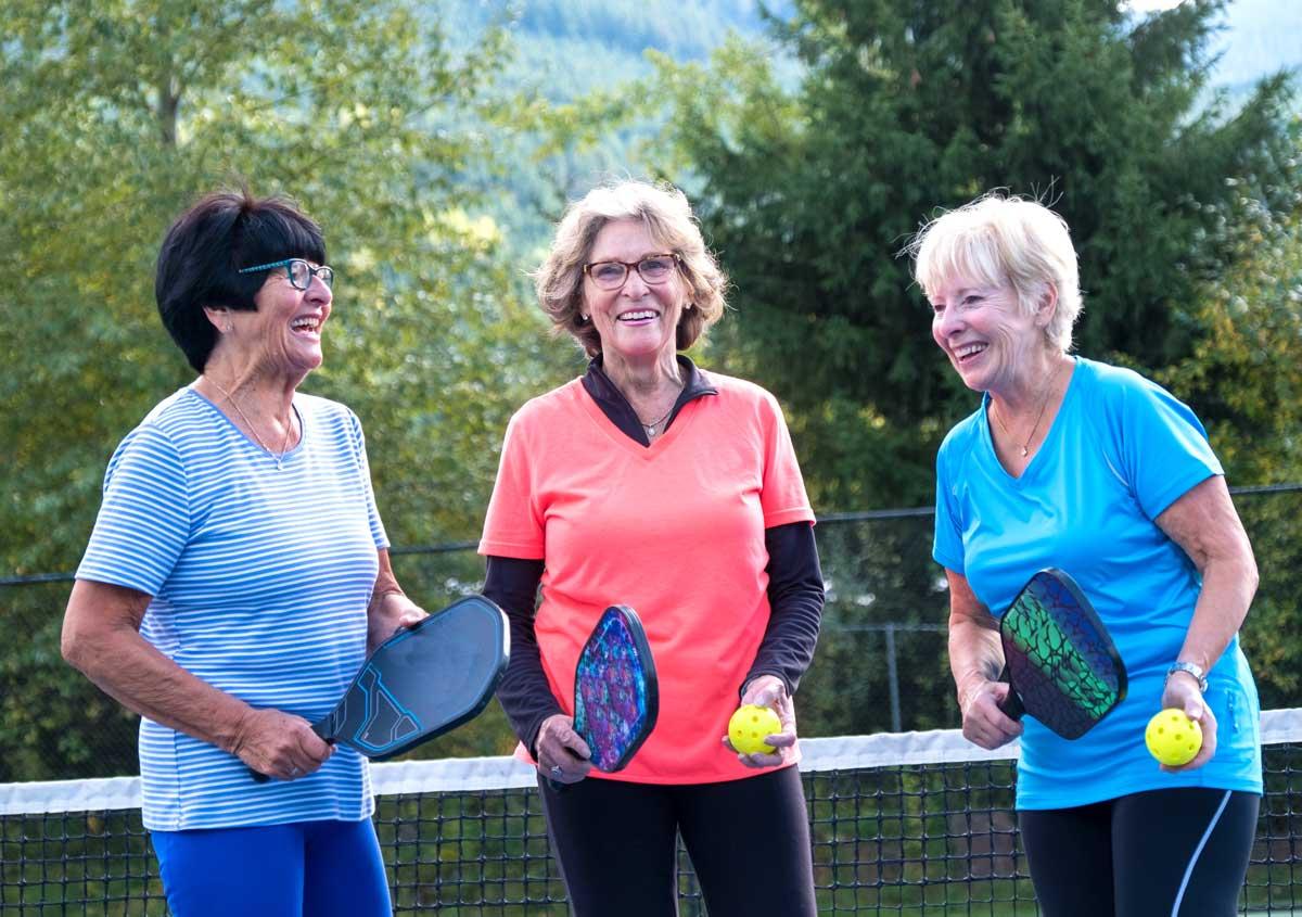 Women playing pickleball