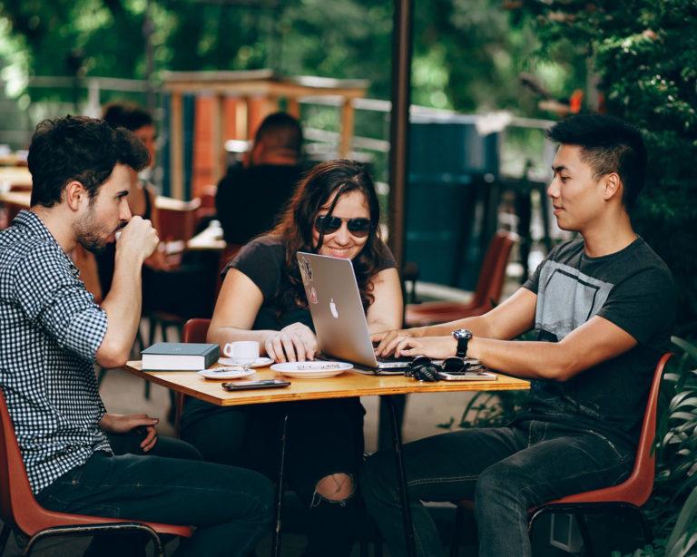 Millennials working in a coffee shop
