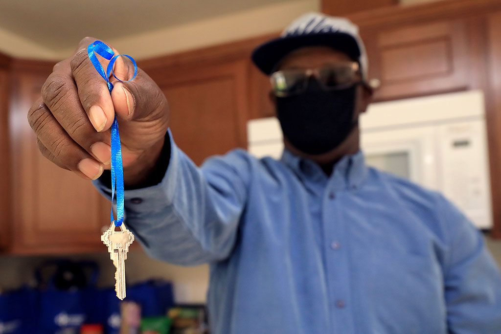 Wardell Newby holds the key to his new Habitat for Humanity home