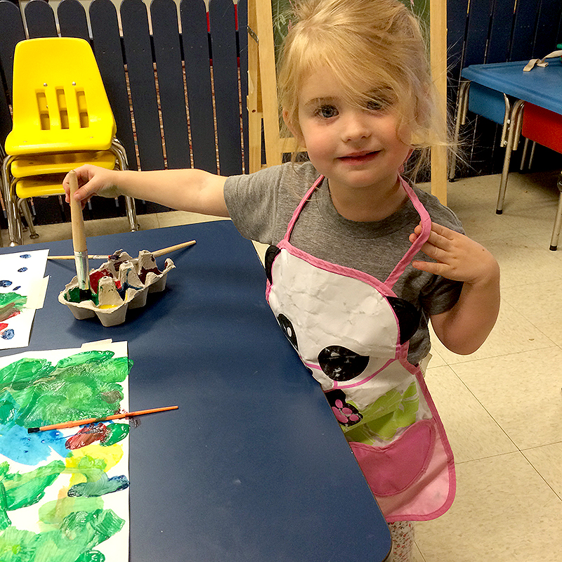Toddler Painting at Cubs Camp Nursery