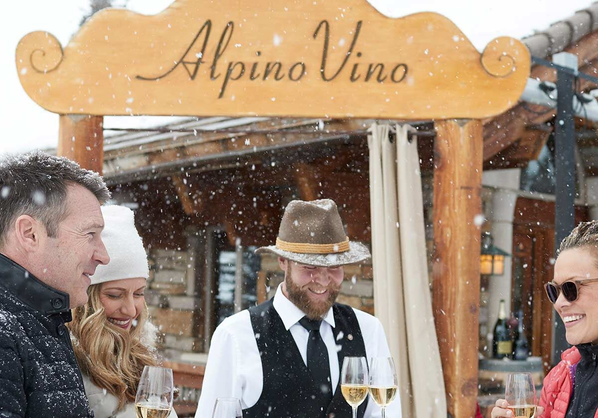 Friends Sharing Wine at Alpino Vino on a Snowy Day