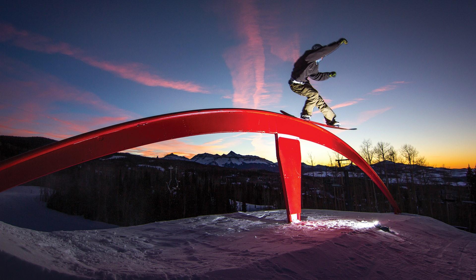 Snowboarder Riding the Rail at Telluride Ski Resort