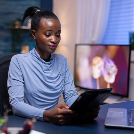 afro-woman-working-remote-Z6WX7FT-min