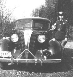 Paul Bell with patrol car