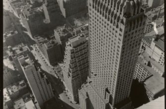 Looking down from a skyscraper at other skyscrapers and New York streets. Chanin Building. New York, 1935