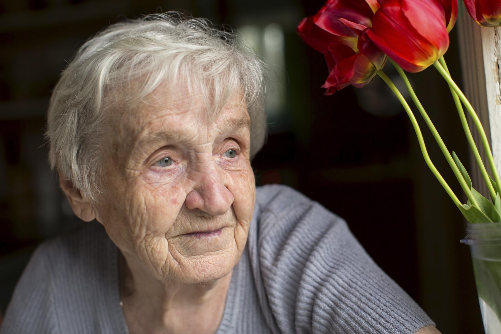 Close-up portrait of an elderly woman.