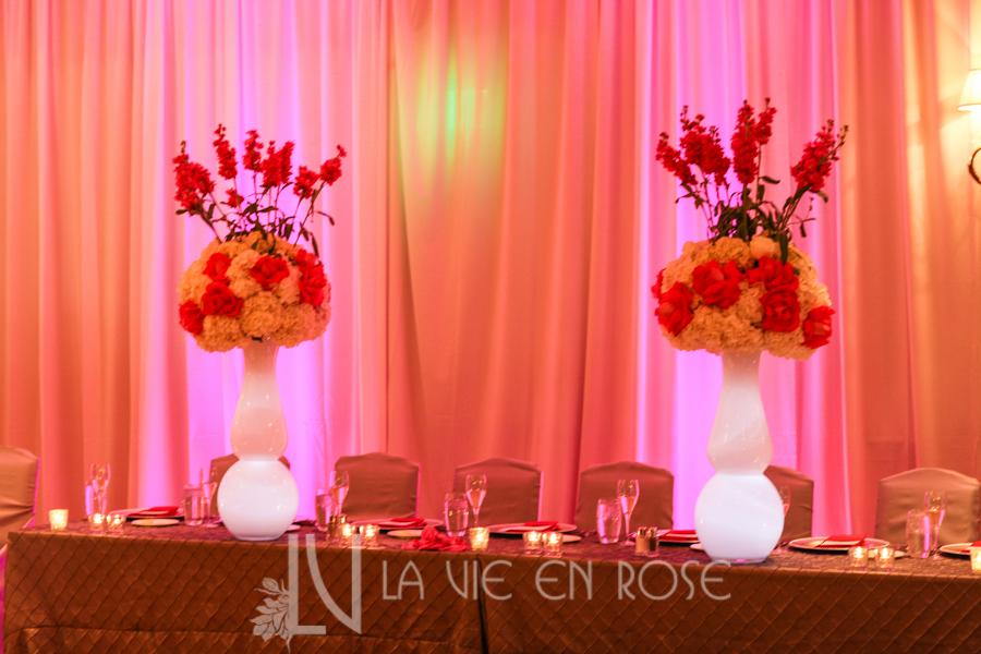 la-vie-en-rose-wedding-centerpiece-silver-chair-cover-linens-LED-up-lighting-head-table-peonies-phalaenopsis-orchid-hydrangea-mini-calla-pink-hyatt-regency-clearwater-beach-florida